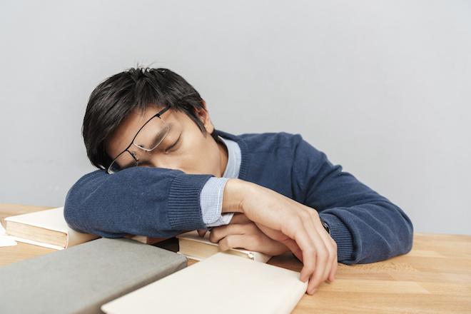 Asian man asleep on the table